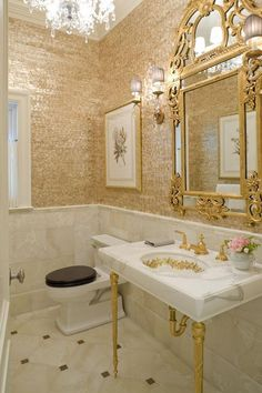 Gilded glam bathroom with mother-of-pearl wall covering and other bling