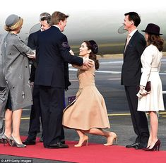 Red carpet treatment: Mary curtsies to King Willem-Alexander while Prince Joachim (right) ...
