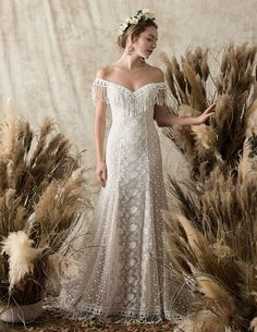 Dreamers and Lovers boho lace wedding dress with sweetheart neckline and fringe     #laceweddingdress #bohoweddingdress