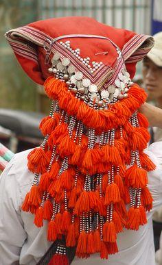 Laos | Red Dzao Headdress.  Sapa. | ©Peter Garnhum