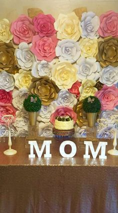 Gorgeous paper flower backdrop at a Mother's Day party! See more party planning ideas at CatchMyParty.com!