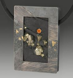 Wolfgang Vaatz: , Pendant of slate with pyrite framed in oxidized sterling silver with fused 18k and 22k gold. Dimensions: 2.56 x 1.78 x 0.3...