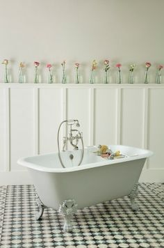 Beautiful roses so pretty in these vintage bottles.  The Marazion Cast Iron bath is painted in Farrow & Ball's soft fresh 'Mizzle'