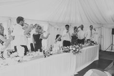 Wedding marquee at Ditton Field - toasting the bride