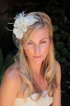 Lela bridal hair accessories , bridal hair flower,  wedding veil Floral Fascinator with birdcage blusher veil. $70.00, via Etsy.