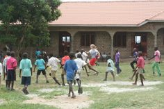 The children playing soccer in front of the new school. www.simoneskids.com Hope In God, Soccer Match, The New School, Primary School, Uganda, Dolores Park, Children, Pictures, Travel