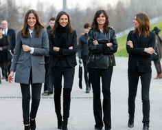 The French Vogue team, Capucine Safyurtlu, Geraldine Saglio, Emmanuelle Alt, and Claire Dhelens strut the streets of Paris.