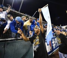 Kansas City Royals players Alcides Escobar (left) and Salvador Perez celebrated with fans after beating Los Angeles Angels 8-3 during Sunday's ALDS playoff baseball game on October 5, 2014 at Kauffman Stadium in Kansas City, MO.