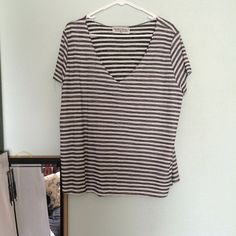 "Urban Outfitters ""Project Social"" Tee grey and white loose fitting v-neck, worn and washed once! Cheaper on mercari @haiimlucy Urban Outfitters Tops"