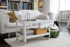 The industrial style IKEA PS 2012 coffee table does double duty, by providing plenty of storage space, too. Casters allow you to move it about freely, placing it where you need it most.
