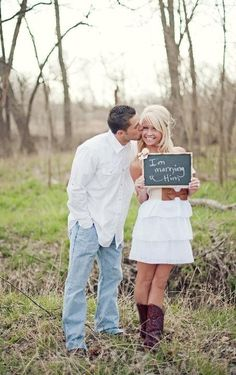 """Cute engagement picture idea. Also liked one where they each hold a little chalkboard--His says: """"I stole her heart..."""" Her's says: """"So I'm stealing his last name!"""""""