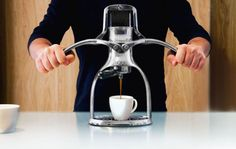 ROK has released a manual espresso maker for the energy conscious. The machine features two polished, high-quality aluminum arms that when lowered trap air to force water through the coffee grounds.