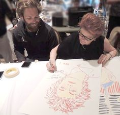 From Marina - #Throwback to #STLV in 2015. #KateMulgrew is signing a #Red print by son, #AlecEgan, who is looking on.