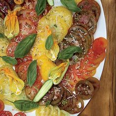 Heirloom tomatoes are drizzled with extra-virgin olive oil and garnished with chopped fresh herbs and Parmesan to make this stupid easy summer salad. Get the recipe from Delish.