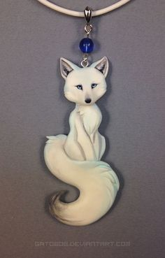 I sculpted a new fox necklace recently Thanks to my recent move to resin, I was able to make it smaller, and with a finer tail-connection. I'll be making more of these as well. [ resin cast from or. Polymer Clay Animals, Fimo Clay, Polymer Clay Projects, Polymer Clay Charms, Polymer Clay Creations, Polymer Clay Jewelry, Clay Crafts, Cute Clay, Fox Art