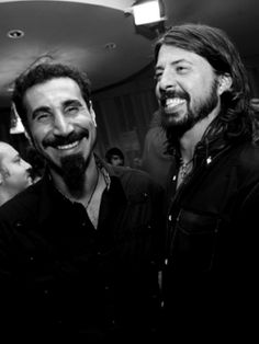 Serj Tankian and Dave Grohl. Ah, they're awesome; I cant believe they're in the same picture together. System Of A Down AND Foo Fighters!