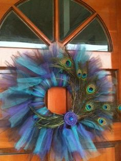 Peacock Tulle Wreath- love this- but thinking the tulle with ornaments for CHristmas- or add eggs for Easter