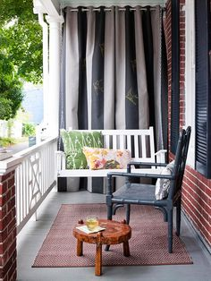 This swinging bench looks lovely with a few patterned pillows.