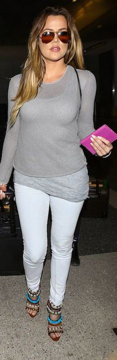 Khloe Kardashian in white skinny jeans, gray sweater and gorgeous Giuseppe Zanotti shoes.