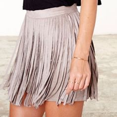 NWT BB Dakota Pearl Faux Suede Fringe Skirt!! NWT BB Dakota Pearl Faux Suede Fringe Skirt!! Size: 8!!! Brand new with original tags still attached!! In perfect condition!! Looks SO cute on!! Back zipper closure. Fringe all the way around. 92% polyester and 8% spandex!! Dry clean OR machine washable!! BB Dakota Skirts Midi