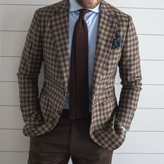 Check jacket, light blue jacket, brown knit tie, brown pants