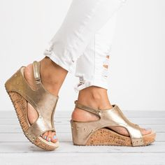 570524850a8 A stylish pair of wedges with a low platform heel and an open toe with cut