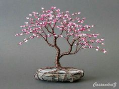 Asymmetrical Cherry Blossom Beaded Bonsai Mini Wire by CassandraZ: I would also perhaps add a swing or wheelbarrow with apples beneath the tree.Discover thousands of images about DIY Beaded Tree with StoneArtificial bonsai as decorIn bonsai growing, Wire Crafts, Bead Crafts, Diy And Crafts, Wire Tree Sculpture, Wire Trees, Metal Tree, Beads And Wire, Wire Art, Spring Colors