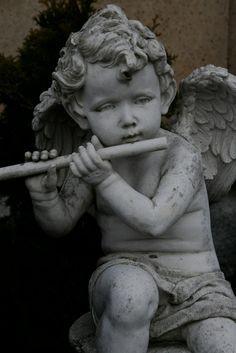 sweet little garden cherub playing the flute~