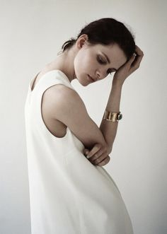 white slip dress gold broad shiny bangle