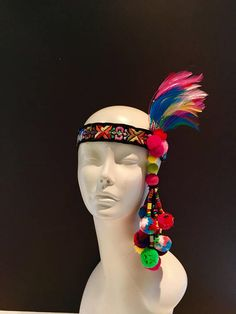 Multi color Headdress- Rainbow feather headdress- Rainbow headband- Pride week- fascinator- Pom poms Hello, I just love Pom poms..so I had to make several things with them! Its is made with 1.25 inch vintage velvet embroidered trim from the 60s. It has 1 inch pom poms that are on the left
