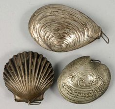 antique silver tape measures in shapes of sea shells ocean seashore beach