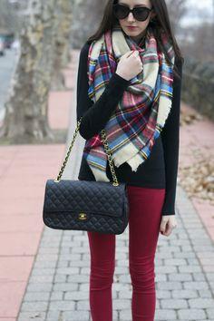 red pants. black long sleeve tee. plaid scarf.