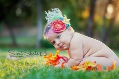Peach Blossom Baby Girl Headband- Hot pink, yellow and orange flower with turqoise rosettes, a yellow bow, green lace and a pearl. $32.98, via Etsy.