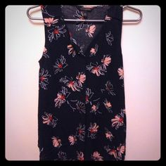 Banana Republic flower print top Gorgeous sleeveless blouse. Navy blue with faint light blue polkadots and white and pink flower print. So pretty with a hidden button down front. Great tucked into a skirt or with jeans or leggings. Excellent condition. Banana Republic Tops Blouses