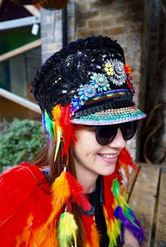 Be inspired by the rainbow, let the colors speak your truth. This UNISEX ONE OF A KIND piece features rainbow sequins, black sequins, rainbow colored feathers and detachable hanging feather chains, gemstones, rhinestones and battery operated LED LIGHTS!  This hat is a size Medium/Large  Handmade in London  Jacket available in other listing  Not eligible for promo codes      Shipping Disclaimer: I SHIP WORLDWIDE - and the prices sometimes vary, so IF I overcharged you I will refund the di...