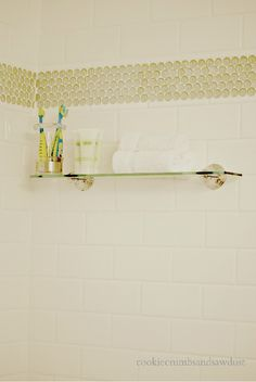 Shower Stall with subway tile and penny tile accent stripe