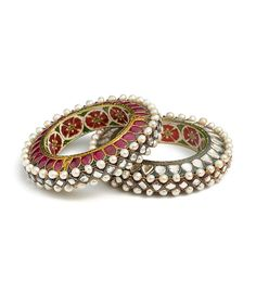 North India - Jaipur | Pair of bangles ~ kada ~ gold, set with rubies, diamonds, pearls; enamel on interior; lac core | ca. 1775 - 1825. | © Al-Thani Collection