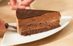 chocolate; homemade, rich, creamy dark chocolate mousse; moist, sweet cocoa cake (oil based), a white chocolate praline paste layer with crushed corn flakes; a dark chocolate glaze