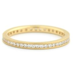 The simple design and flawless execution of this mini eternity band enables the piece to retain a sense of purity.