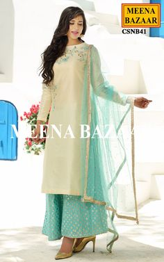 Featuring thread embroidery and hand work, this classy and contemporary cream chanderi sharara suit will definitely charm yourself up. Comes with banarasi chanderi sharara and net dupatta with swaroski work. Indian Designer Suits, Designer Silk Sarees, Designer Dresses, Pakistani Dresses, Indian Dresses, Indian Outfits, Indian Attire, Indian Wear, Sharara Suit