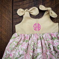 Monogrammed knot dress, pink green paisley damask, circle monogram dress, newborn 0-3, 3-6, 6-12, 12-18, 18-24 birthday outfit, easter, by ShelbyJaneandCo on Etsy https://www.etsy.com/listing/216579541/monogrammed-knot-dress-pink-green