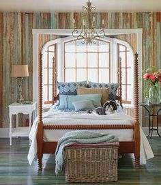 """The Jenny Lind-style bed is one of the few furnishings the owners of this Victorian Arkansas cottage kept in the bedroom. """"I wanted a mix of elegant pieces and primitive ones,"""" she says. The shams and duvet cover are West Elm; the coverlet is Garnet Hill."""