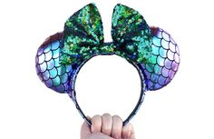 "Promising Review: ""Loved this for my recent Disney trip! I didn't see anyone else with the same ears, and got several compliments. I usually have issues wearing headbands all day, but this was comfortable and I had no headaches. So happy with these!!"" —Katie AndersonGet them from OctostacheCrafts on Etsy for $16.99."