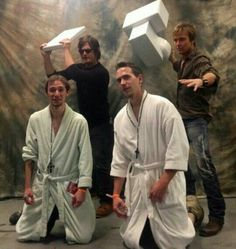 Norman Reedus and Sean Patrick Flanery posing with fans with a scene from Boondock Saints.