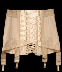 Debenham and Freebody Corset 1914. From the Victoria & Albert Museum. The criss-crossing ribbon allowed for ease of movement and was the beginning of the girdle.