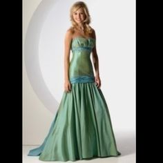 BrandNew! Green/blue dress By Maggie sottero size6 Brand new- green/blue evening/prom dress size 6 . Steal the show in this gorgeous dress! It has beading, sequence and a corset tie-up back for a great form fitting look! Dresses Prom