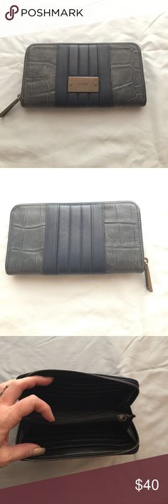 LAMB wallet gently used 😎 Wallet by LAMB. Dark blue. Gently used. 7 1/2x4x1.  12 card slots, slip pockets and a center zip pocket/change. This is a gorgeous wallet! LAMB  Bags Wallets