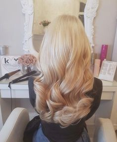 long curly hairstyle   wavy   waves   curls   blonde   bleached   platinum   hairdo   with hair extensions
