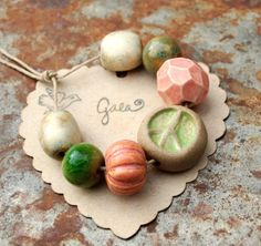 Gaea handmade ceramic design elements and adornments! | gaea.cc  Peace and Love - Pink and green handmade ceramic peace bead set.
