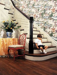 A classic yet exotic indulgence.  I don't know if I could live with this all the time but love this staircase + floor........Scalamandre Shanghai wallpaper.  Oohh and that red chair.